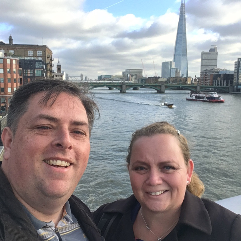 couple on bridge over river thames